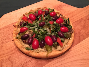 Plant-based, vegan cornmeal crust pizza